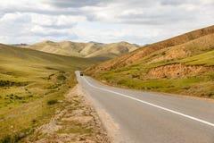 Asphalt road Darkhan-Ulaanbaatar in Mongolia. Asian Highway royalty free stock image