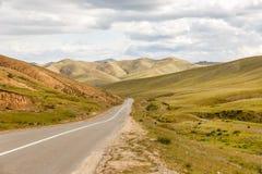 Asphalt road Darkhan-Ulaanbaatar in Mongolia. Asian Highway, Mongolia royalty free stock image