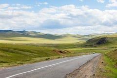 Asphalt road Darkhan-Ulaanbaatar in Mongolia. Beautiful Mongolian landscape, Aymak Tuve royalty free stock image