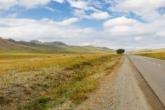 Asphalt road Darkhan-Ulaanbaatar in Mongolia. Beautiful Mongolian landscape, Tuve Aymak. Baruunkharaa stock photos