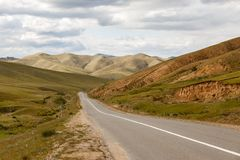 Asphalt road Darkhan-Ulaanbaatar in Mongolia. Beautiful landscape royalty free stock image