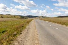 Asphalt road Darkhan-Ulaanbaatar in Mongolia. Beautiful landscape, central Province, Tov Province royalty free stock image