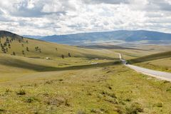 Asphalt road Darkhan-Ulaanbaatar in Mongolia. Mongolian landscape stock photos