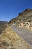 Asphalt road in desert Royalty Free Stock Photo