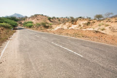 Asphalt road in desert area Stock Photo