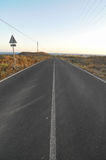 Asphalt Road in the Desert Royalty Free Stock Images