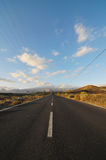 Asphalt Road in the Desert Royalty Free Stock Photos