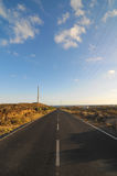 Asphalt Road in the Desert Stock Photos