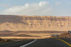 Asphalt road in desert Negev, Israel, road 40, transport infrast. Ructure in desert, scenic mountains route in Mizpe Ramon canyon in Israel Stock Photography