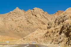 Asphalt road in desert Negev, Israel, road 12, transport infrast. Ructure in desert, scenic mountains route from Eilat to north of Israel Royalty Free Stock Photos