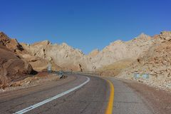 Asphalt road in desert Negev, Israel, road 12, transport infrast. Ructure in desert, scenic mountains route from Eilat to north of Israel Stock Photos