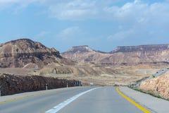 Asphalt road in desert Negev, Israel, road 40, transport infrast. Ructure in desert, scenic mountains route in Mizpe Ramon canyon in Israel Stock Photos