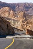 Asphalt road in desert Negev, Israel, road 40, transport infrast. Ructure in desert, scenic mountains route from Eilat to north of Israel Royalty Free Stock Photos