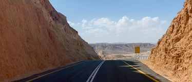 Asphalt road in desert Negev, Israel, road 40, transport infrast. Ructure in desert, scenic mountains route from Eilat to north of Israel Stock Photography
