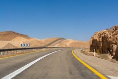 Asphalt road in desert Negev, Israel, road 40, transport infrast. Ructure in desert, scenic mountains route from Eilat to north of Israel Royalty Free Stock Image