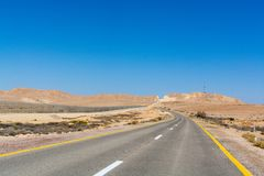 Asphalt road in desert Negev, Israel, road 40, transport infrast. Ructure in desert, scenic mountains route from Eilat to north of Israel Stock Photos