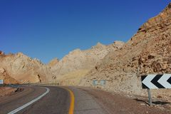 Asphalt road in desert Negev, Israel, road 12, transport infrast. Ructure in desert, scenic mountains route from Eilat to north of Israel Royalty Free Stock Photography