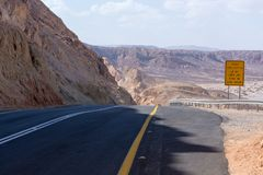 Asphalt road in desert Negev, Israel, road 40, transport infrast. Ructure in desert, scenic mountains route from Eilat to north of Israel Royalty Free Stock Photo