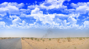 Asphalt road into the Desert outside the city Royalty Free Stock Images
