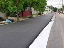 Asphalt road in a development project has got already half royalty free stock images
