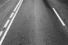 Asphalt road with dividing lines and perspective effect Royalty Free Stock Photos