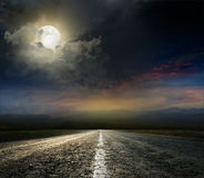 Asphalt road. Dramatic sky over an asphalt road stock photos