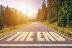 Asphalt road with The End text. Asphalt road with The End text Stock Images