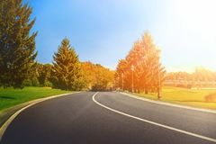 A asphalt road in a field. Asphalt road in a field Royalty Free Stock Photography