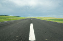 Asphalt road in field Stock Images