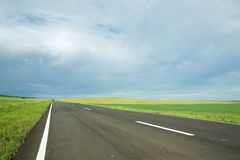 Asphalt road in field Stock Photo