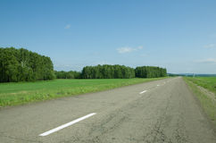Asphalt road in field Stock Photos