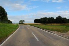 Asphalt road among fields Stock Image