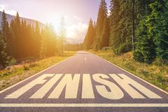 Asphalt road with finish line message. stock photography