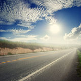 Asphalt road in forrest and bule sky  for transportation Royalty Free Stock Photos