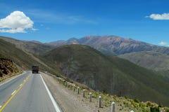 Asphalt road going straight Stock Images