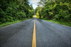 Asphalt road, going to the sky stock photo