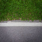 Asphalt road with green grass. Outside Stock Photo