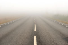 Asphalt road in heavy fog Stock Photo
