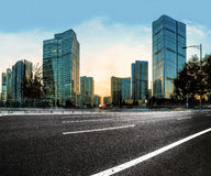 Asphalt road High way with city background Royalty Free Stock Photos
