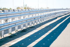 Asphalt road on the highway with protective structure Stock Photography