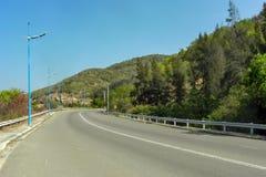 Asphalt road through the hills stock photos