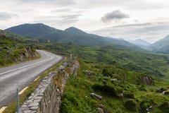 Asphalt road and hills at connemara in ireland Royalty Free Stock Image
