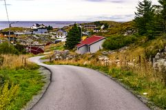 An asphalt road on the island. Around the buildings. Royalty Free Stock Photography