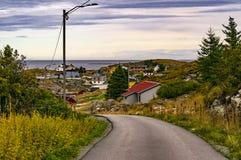 An asphalt road on the island. Around the buildings. Stock Photography