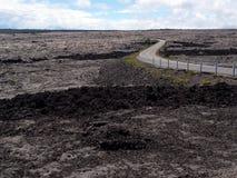 Asphalt road through the lava field Stock Photo