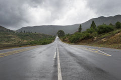 Asphalt road leading into the distance Royalty Free Stock Photo