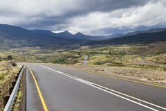 Asphalt road leading into the distance Stock Images