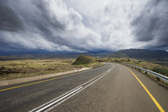 Asphalt road leading into the distance. In the Lesotho mountains Stock Photo
