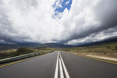 Asphalt road leading into the distance Stock Photos