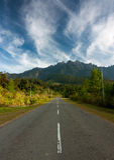 Asphalt road leading to Mount Kinabalu Royalty Free Stock Image
